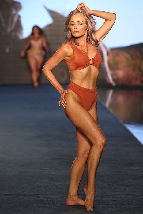 MIAMI, FLORIDA - JULY 10: Kathy Jacobs walks for 2021 Sports Illustrated Swimsuit Runway Show during Paraiso Miami Beach at Mondrian South Beach on July 10, 2021 in Miami, Florida. (Photo by John Parra/Getty Images for Sports Illustrated)